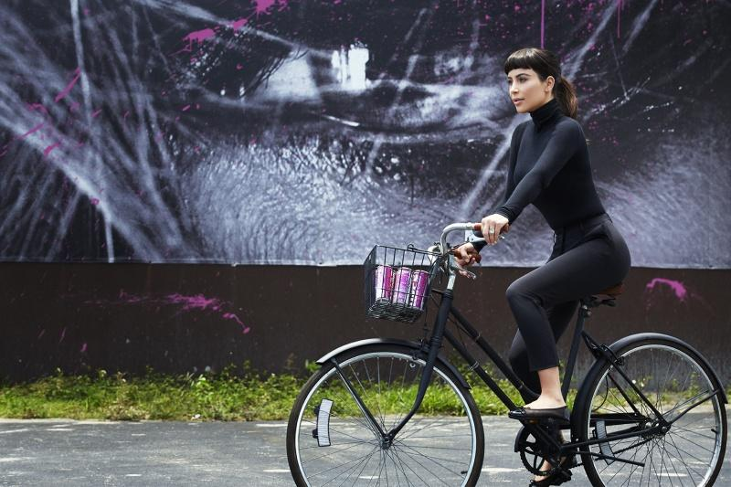 Kim Kardashian West riding a bicycle during her photoshoot with Hype Energy USA
